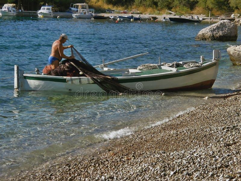 小船渔夫净额 库存照片