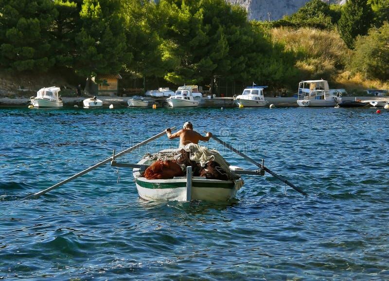 小船渔夫桨 免版税库存照片