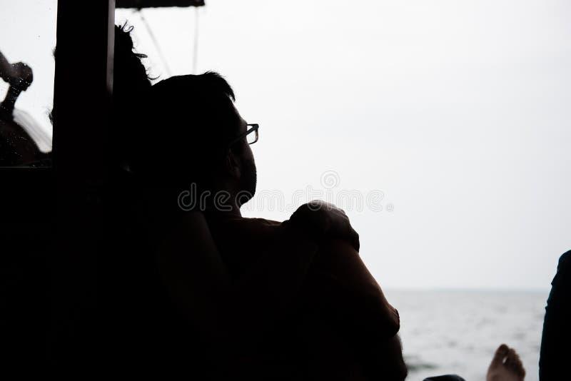 小船的男性游人 库存图片