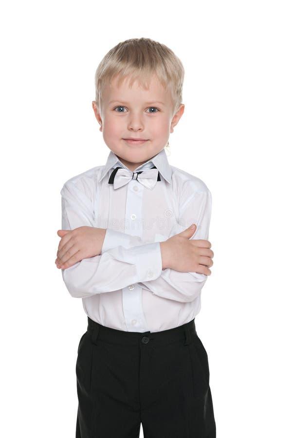 小英俊的男小学生 图库摄影