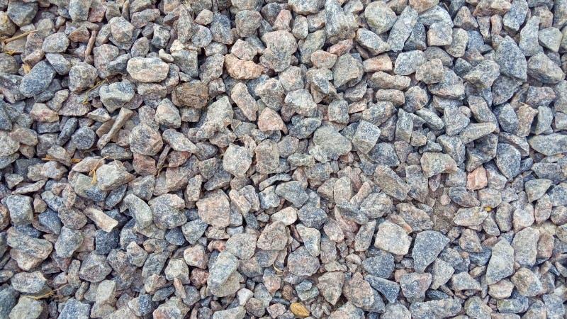 小路石头背景,黑暗的石渣小卵石石纹理,花岗岩,大理石 库存图片