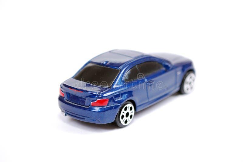 小轿车系列蓝色BMW 135汽车的玩具模型在白色背景的 免版税库存图片