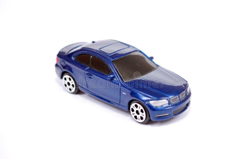 小轿车系列蓝色BMW 135汽车的玩具模型在白色背景的 免版税库存照片