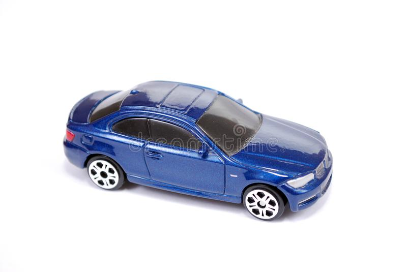 小轿车系列蓝色BMW 135汽车的玩具模型在白色背景的 库存照片