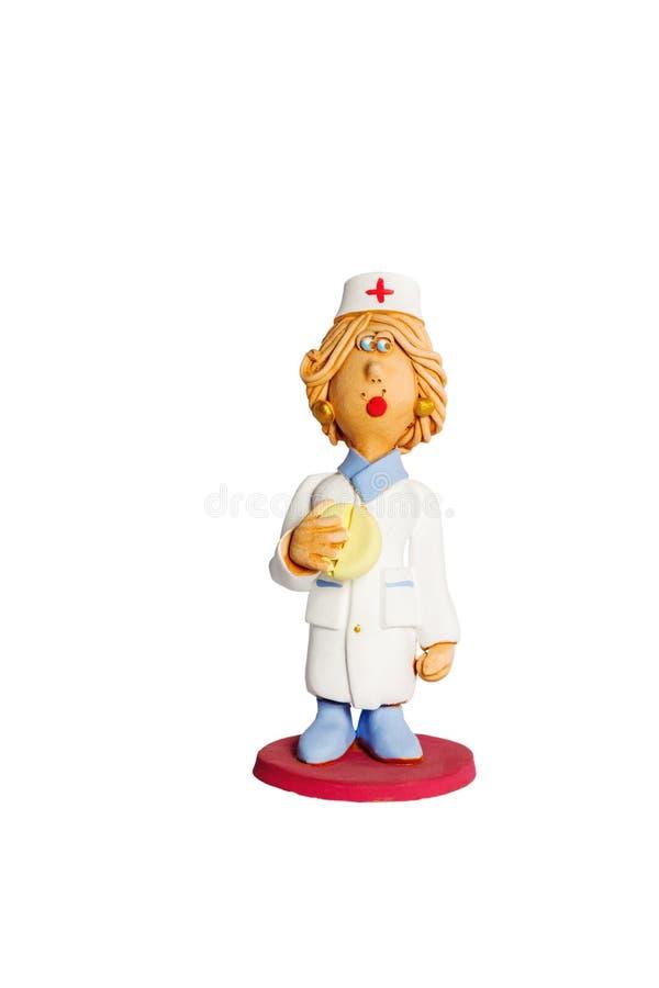 小雕象有药片的公共卫生工作者 库存图片