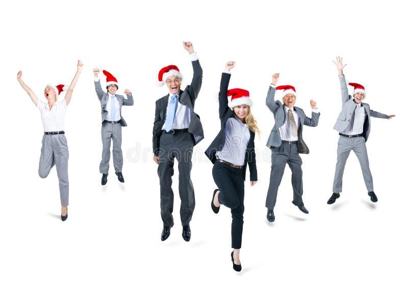 小组戴圣诞老人帽子的商人 图库摄影