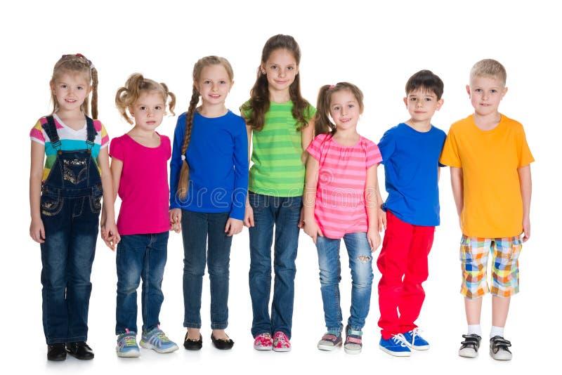 小组孩子一起站立 库存照片