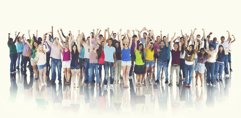 小组愉快的学生庆祝快乐的概念 库存照片