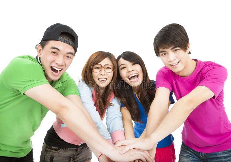 Download 年轻小组用一起手 库存图片. 图片 包括有 运行, 人们, 偶然, 当事人, 幸福, 成人, 庆祝, 友谊 - 30338045