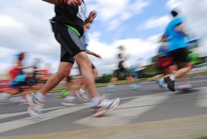小组赛跑者,情感被弄脏的图象 库存照片