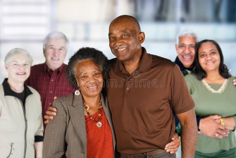 小组年长夫妇 库存照片