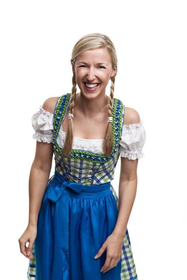 少女装的笑的少妇 免版税库存照片