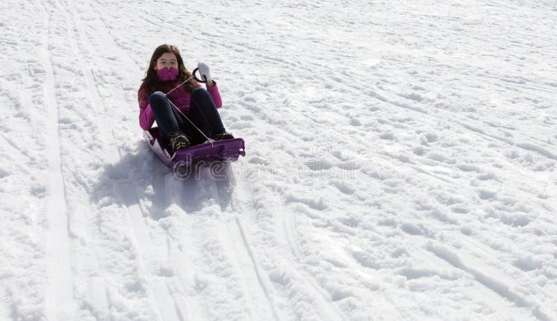 少女sledding 库存照片