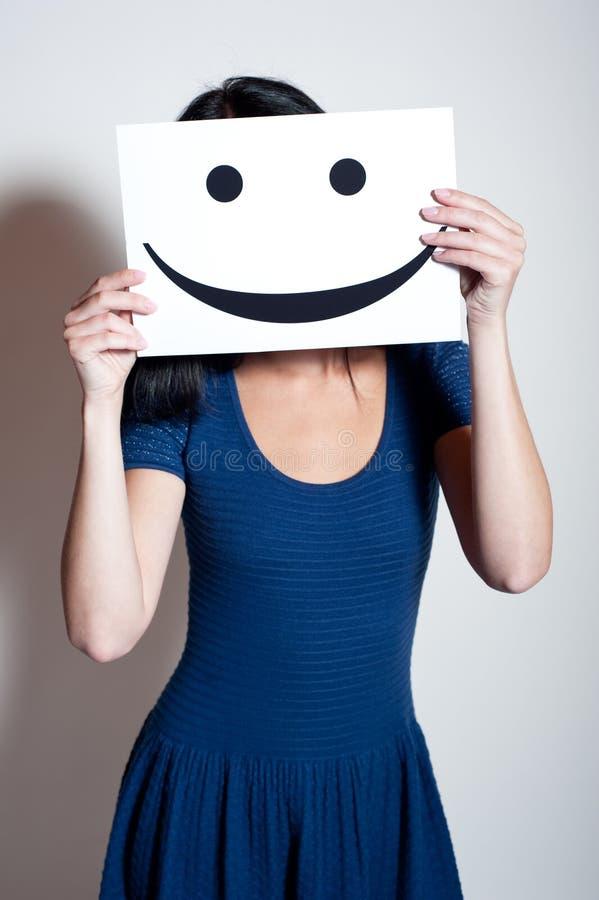 少妇举行微笑 免版税库存图片