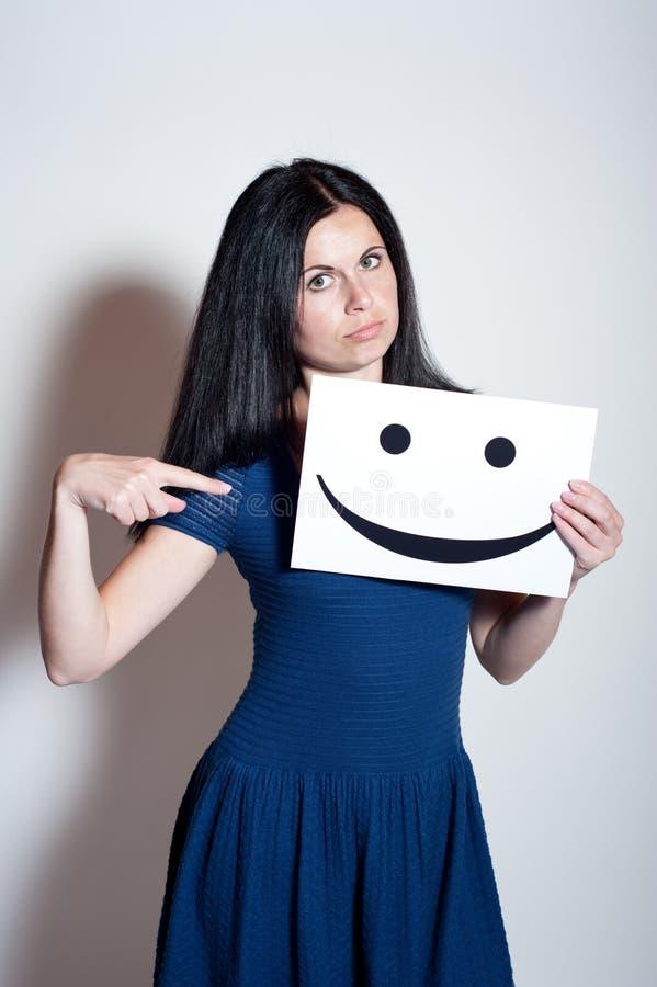 少妇举行微笑 免版税库存照片