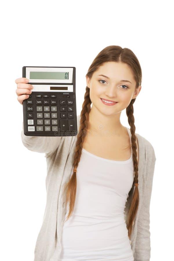 少妇举行数字式计算器 库存图片