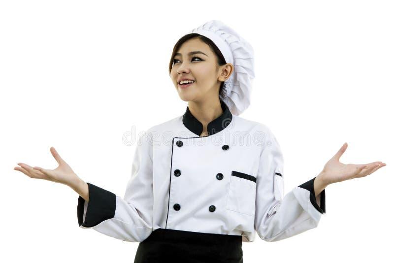少妇厨师画象白色背景的 免版税图库摄影