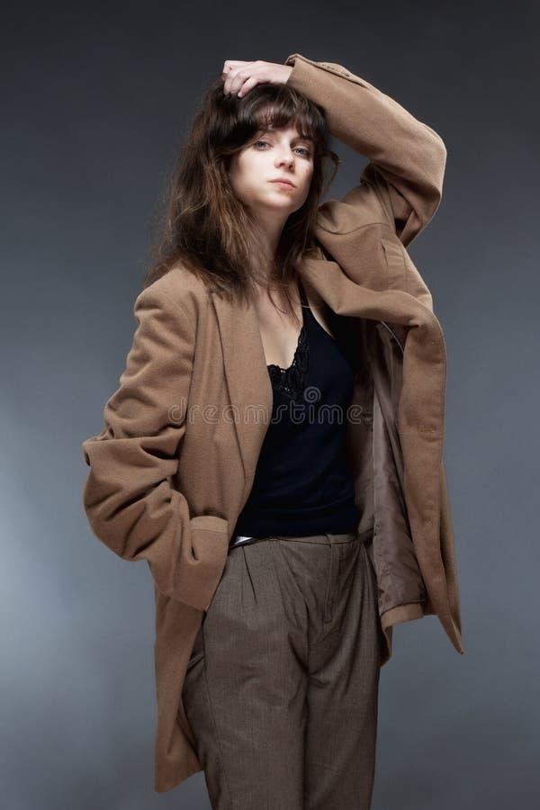 少妇在布朗外套 库存照片