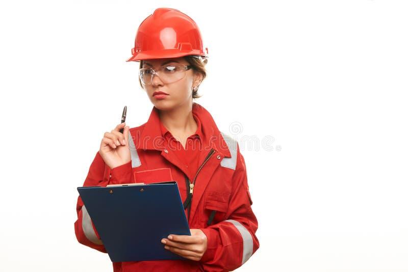 少妇工程师和技术员 免版税库存照片