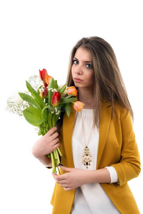 少妇拿着郁金香花束  库存照片