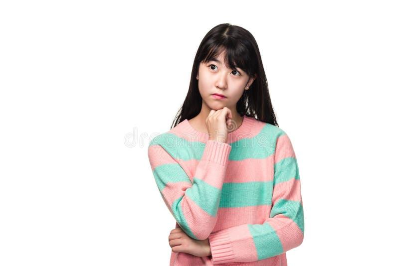 少年东亚妇女演播室画象担心和认为 免版税图库摄影