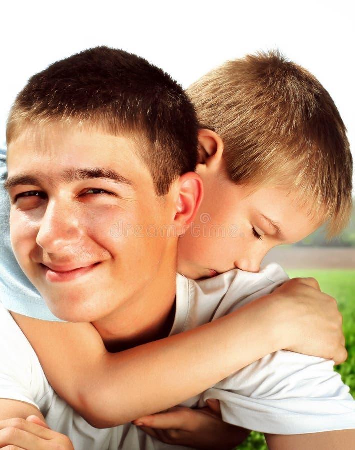 少年和孩子 库存图片