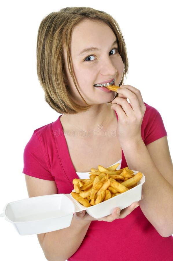 少年炸薯条的女孩 库存图片