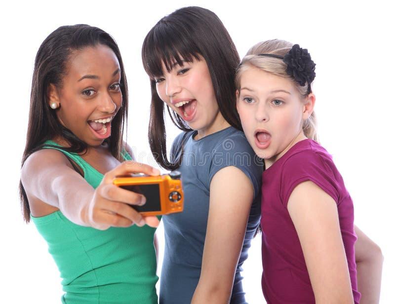 少年照相机数字式乐趣女孩的摄影 库存照片