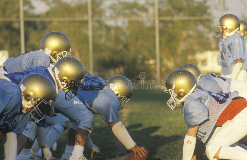少年联盟橄榄球 库存图片