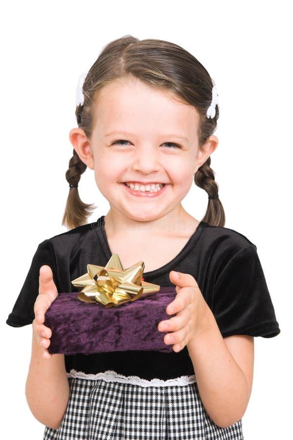 少许产生礼品的女孩 图库摄影