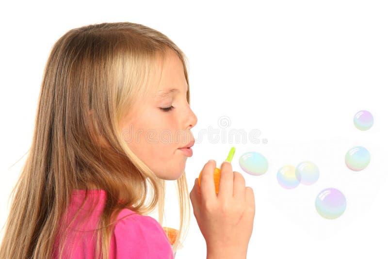 少许俏丽吹的泡影的女孩 库存照片