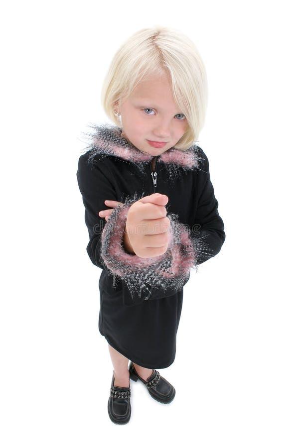 少许恼怒的美丽的黑体字拳头女孩佩带 免版税库存图片