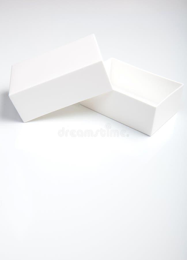 少许白色箱子 库存照片