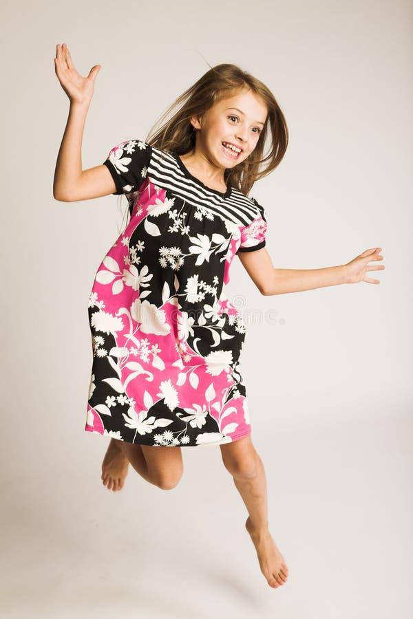 少许跳女孩的喜悦 免版税库存照片