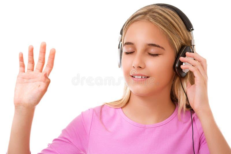 少年可爱的女孩的图片有耳机听的音乐的 库存图片