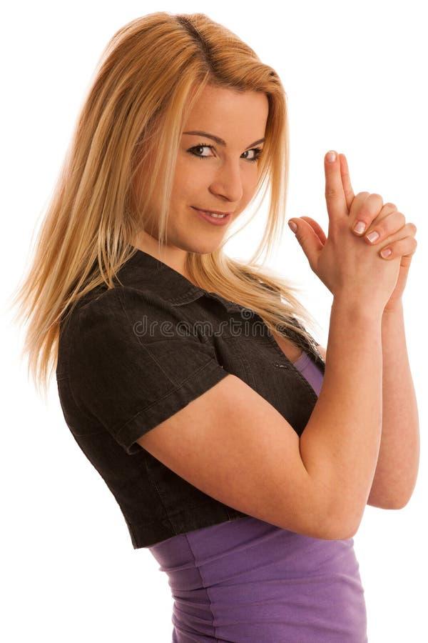 年轻少年妇女握在枪形状的手作为p的标志 库存照片