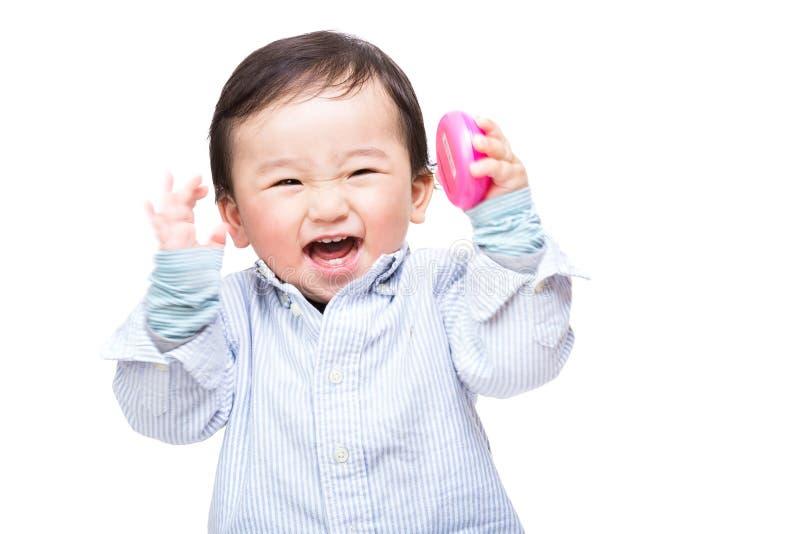 尖叫亚裔的婴孩 免版税库存照片