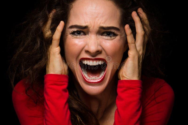 尖叫恼怒,绝望的妇女 免版税库存照片