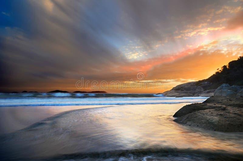 从尖叫的海滩的日落 库存照片