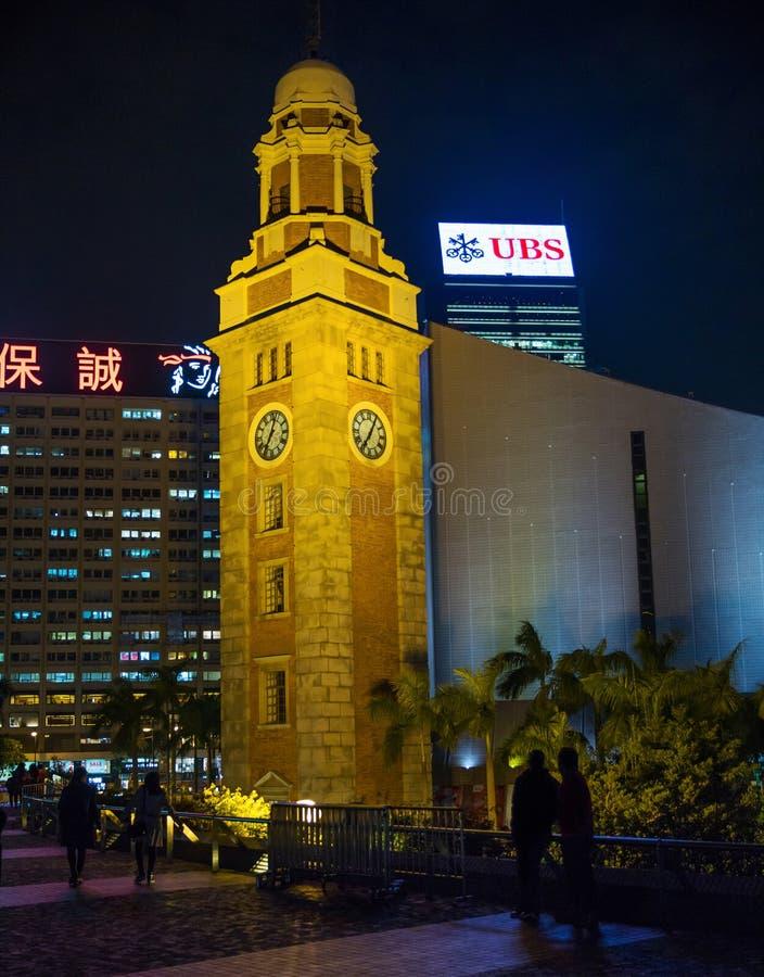 尖沙咀钟楼香港在晚上 免版税库存照片