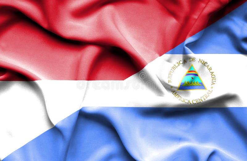 尼加拉瓜和印度尼西亚的挥动的旗子 库存例证
