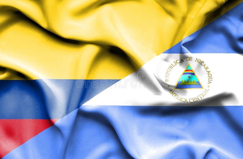 尼加拉瓜和哥伦比亚挥动的旗子  皇族释放例证