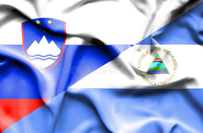 尼加拉瓜和斯洛文尼亚的挥动的旗子 皇族释放例证