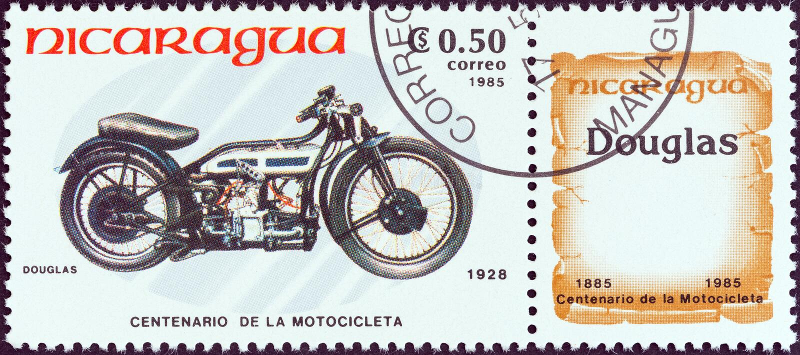 尼加拉瓜-大约1985年:在尼加拉瓜打印的邮票显示道格拉斯,1928年,大约1985年 免版税库存照片