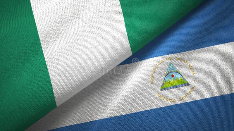 尼日利亚和尼加拉瓜两旗子纺织品布料,织品纹理 皇族释放例证