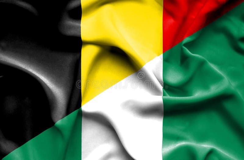 尼日利亚和比利时的挥动的旗子 皇族释放例证