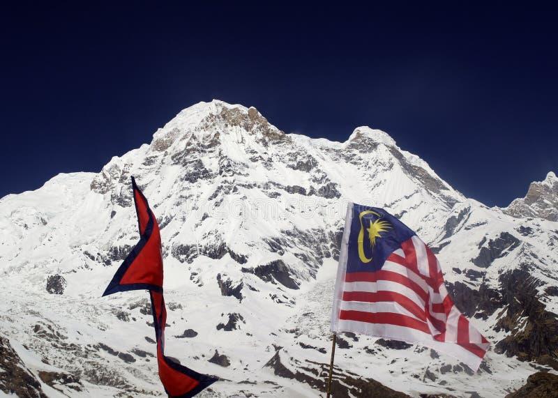 尼泊尔和马来西亚的旗子在ABC中 库存照片