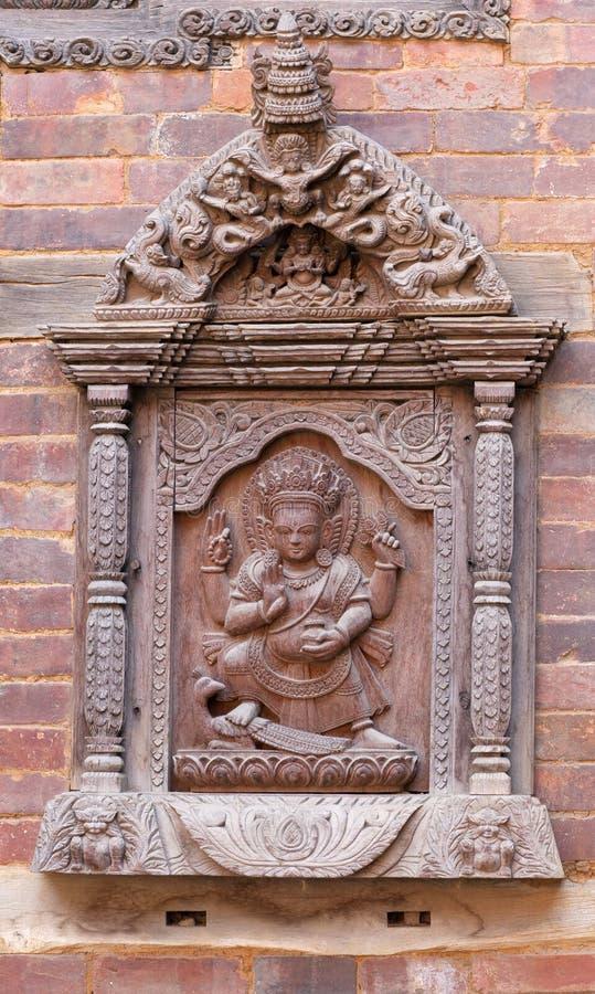 尼泊尔木雕刻在宫殿在Patan,尼泊尔 免版税库存图片