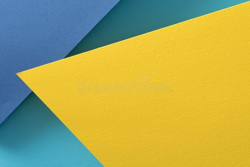 层状作图纸背景黄色蓝色 免版税库存图片