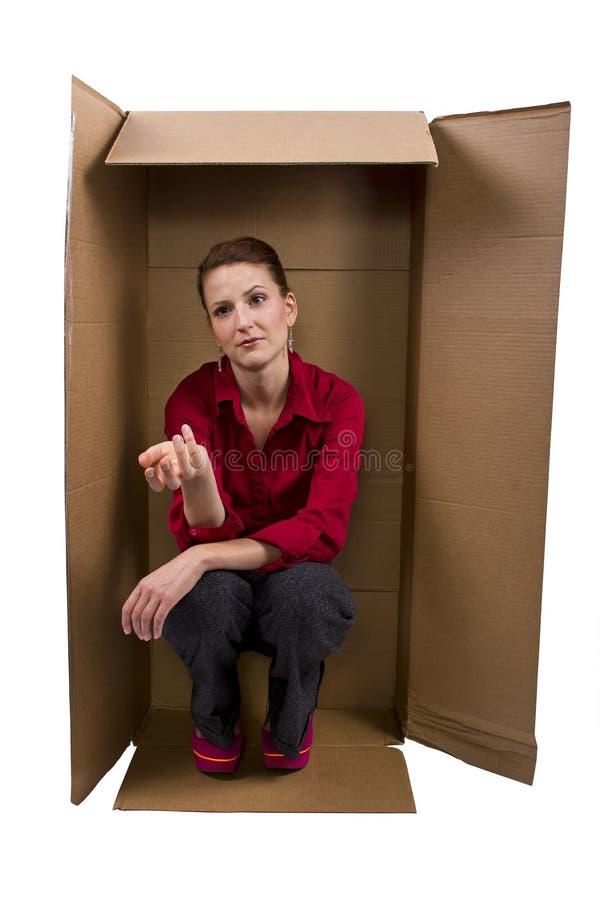 居住在箱子 库存照片
